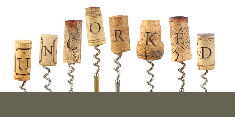 corks with superimposed letters that spell uncorked